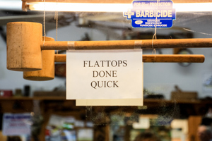 Wooden mallet and 'Flattops Done Quick' sign