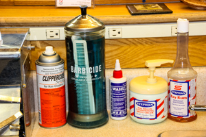Barbercide, Bay Rum and other supplies on the counter